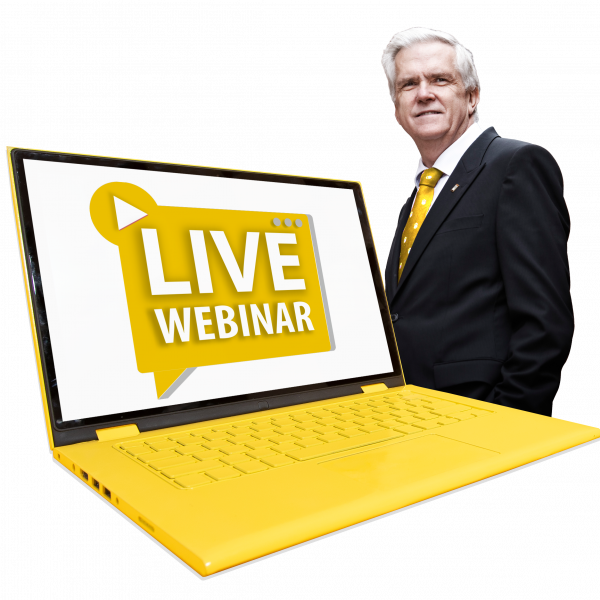 "Allan Manning standing behind a yellow laptop with ""Live webinar"" on the screen"
